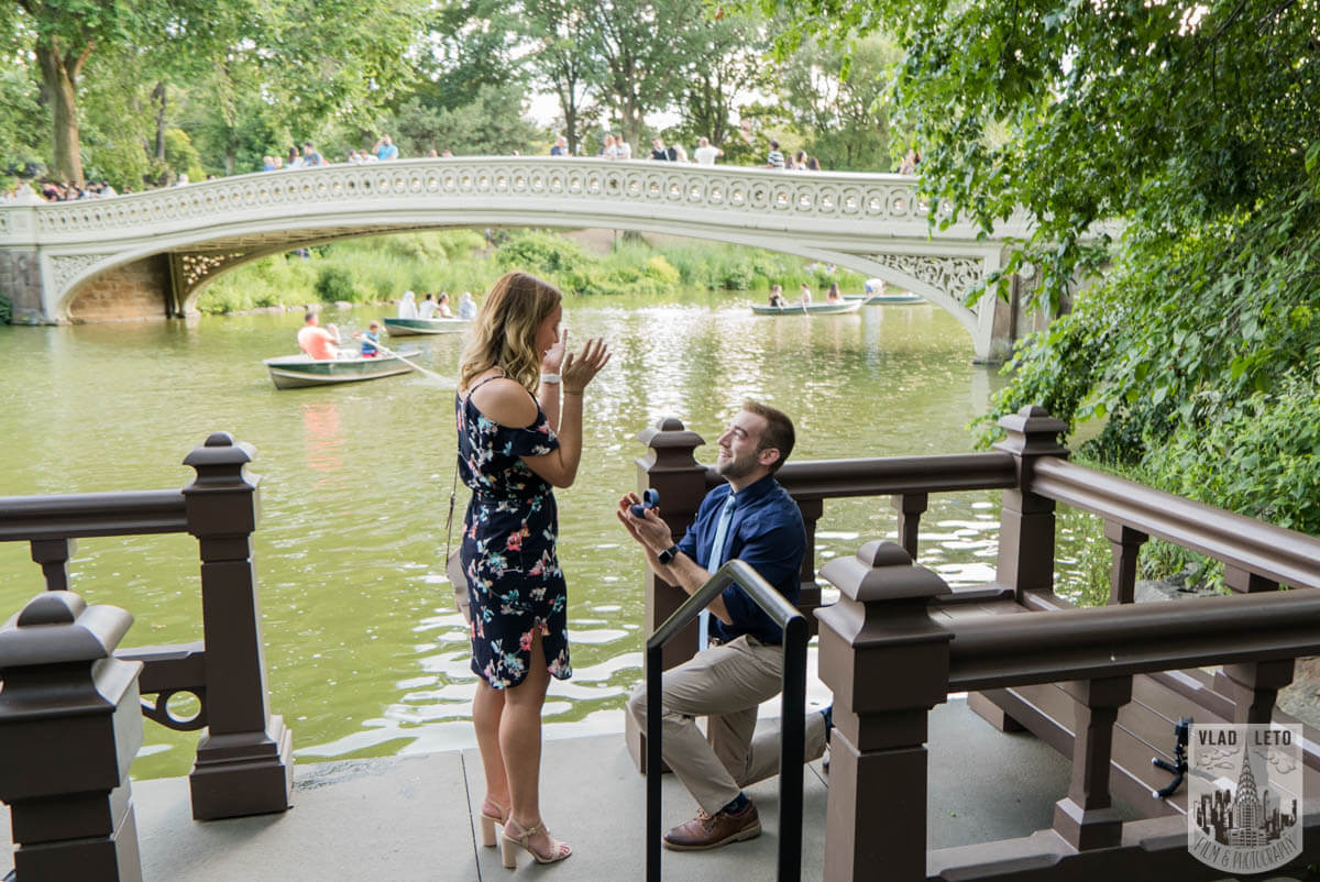 Wedding proposal by Bow Bridge in Central Park