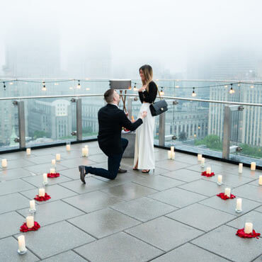 Photo Surprise Proposal on a rooftop in Downtown Manhattan. | VladLeto