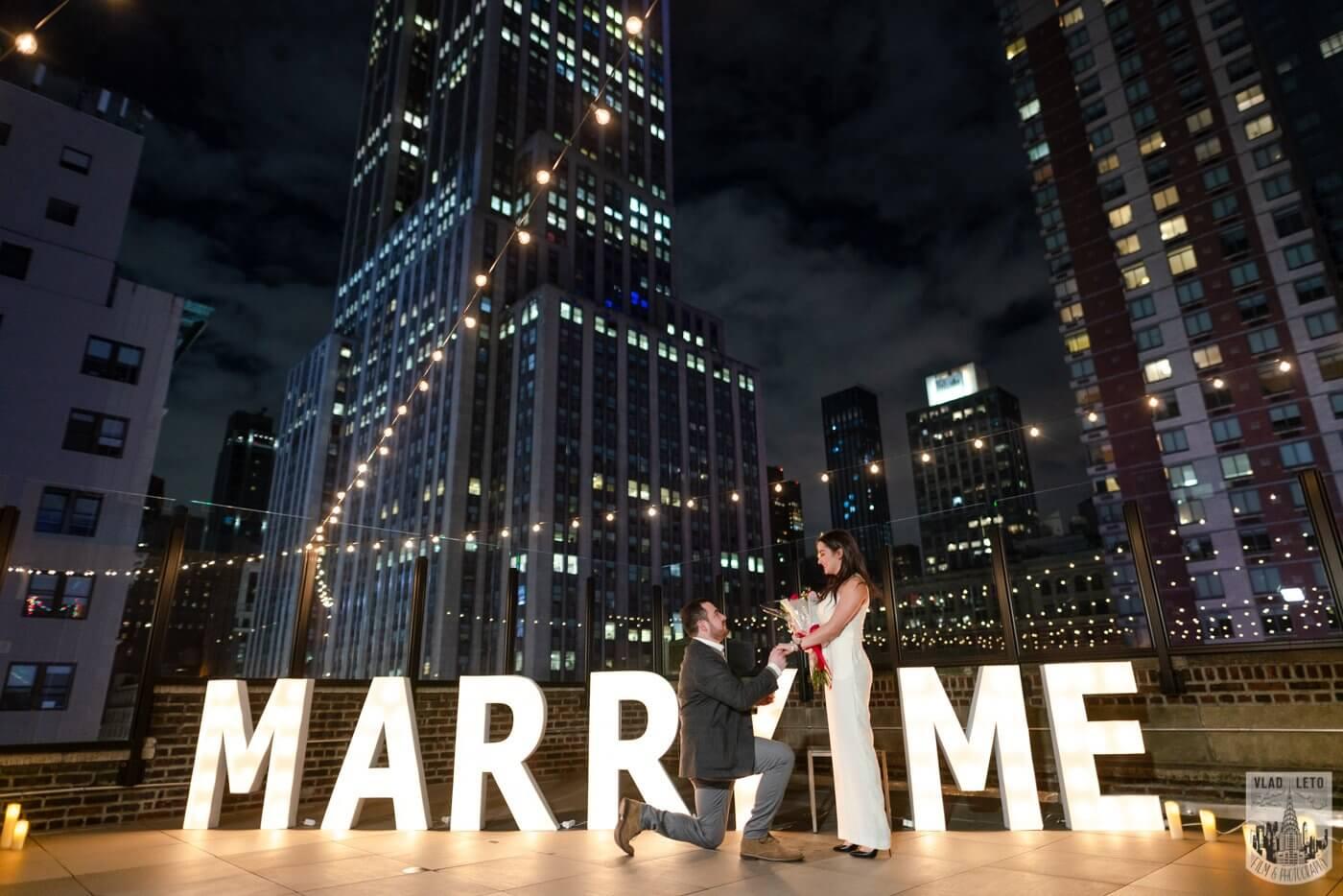Photo 3 Gigantic Marry Me Letters Rooftop Proposal | VladLeto