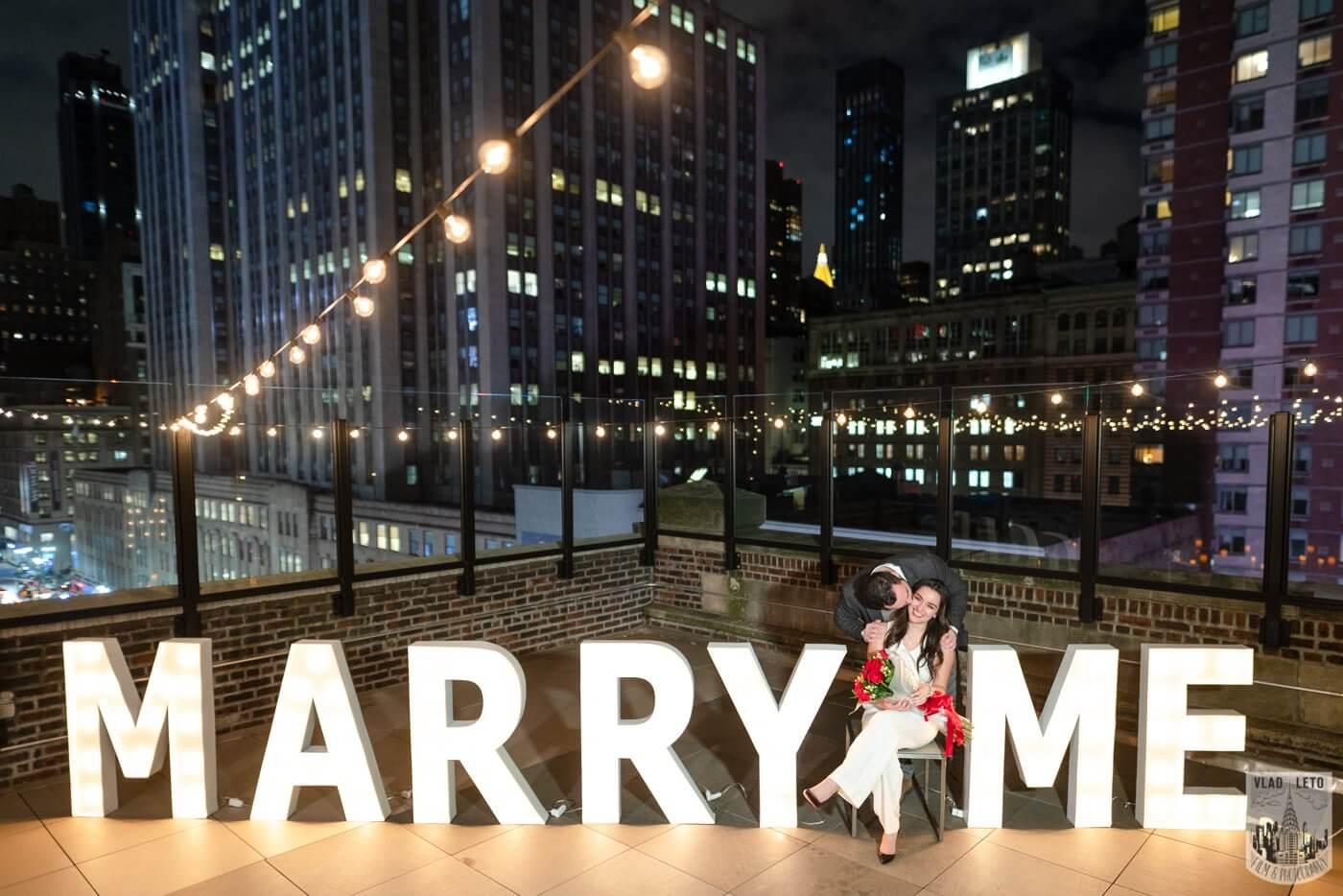 Photo 13 Gigantic Marry Me Letters Rooftop Proposal | VladLeto