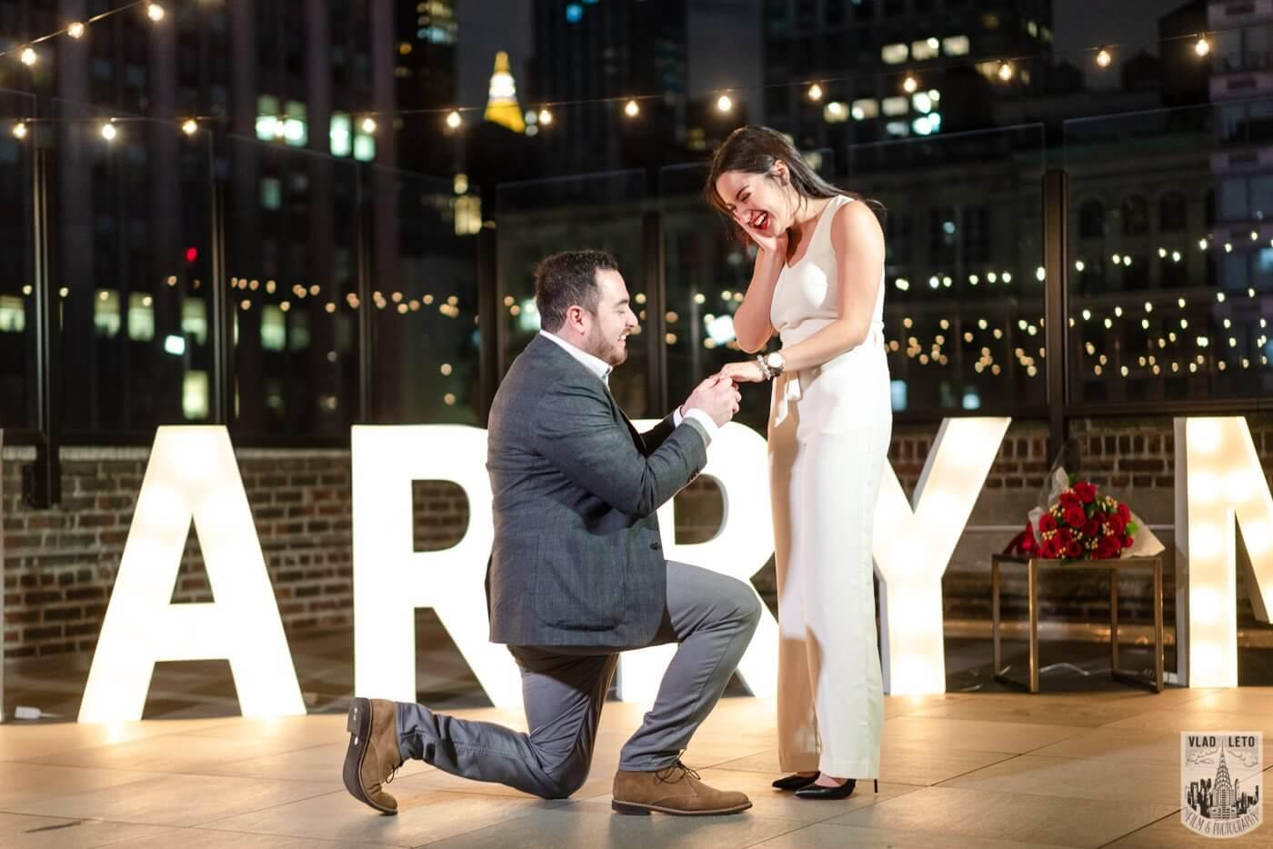 Photo Gigantic Marry Me Letters Rooftop Proposal | VladLeto