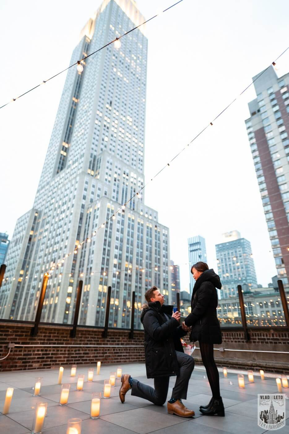 Photo Wedding proposal on a private rooftop with Empire State building view.   VladLeto