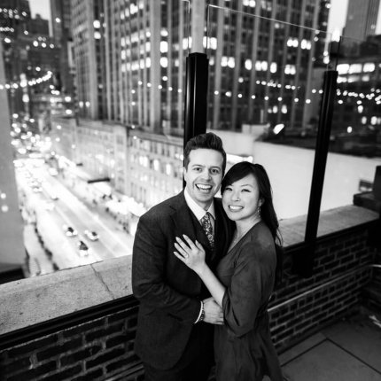 Wedding proposal on a private rooftop with Empire State building view.