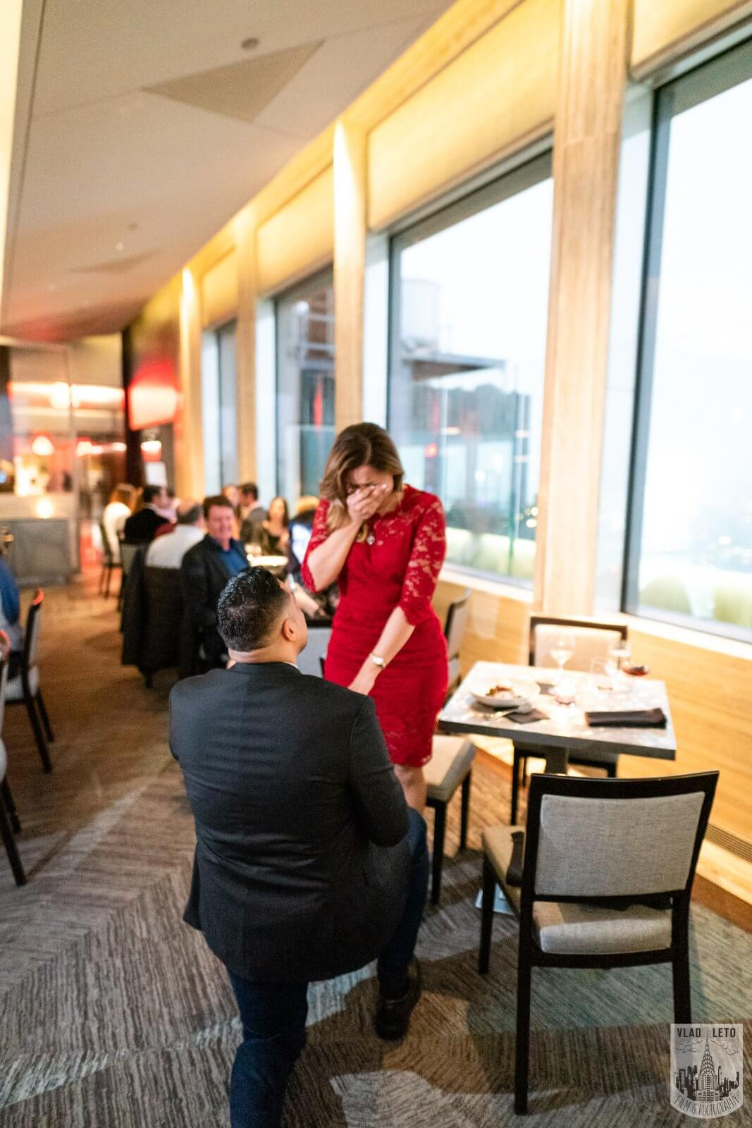 Photo Surprise proposal in a restaurant in NYC. | VladLeto
