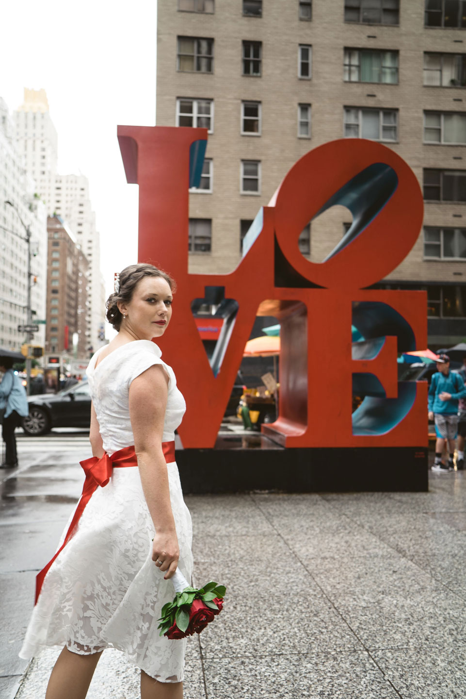 Photo of a bride by Love sign in Manhattan
