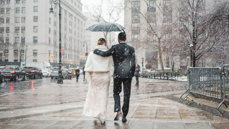 Photo of just married couple in NYC under the snow